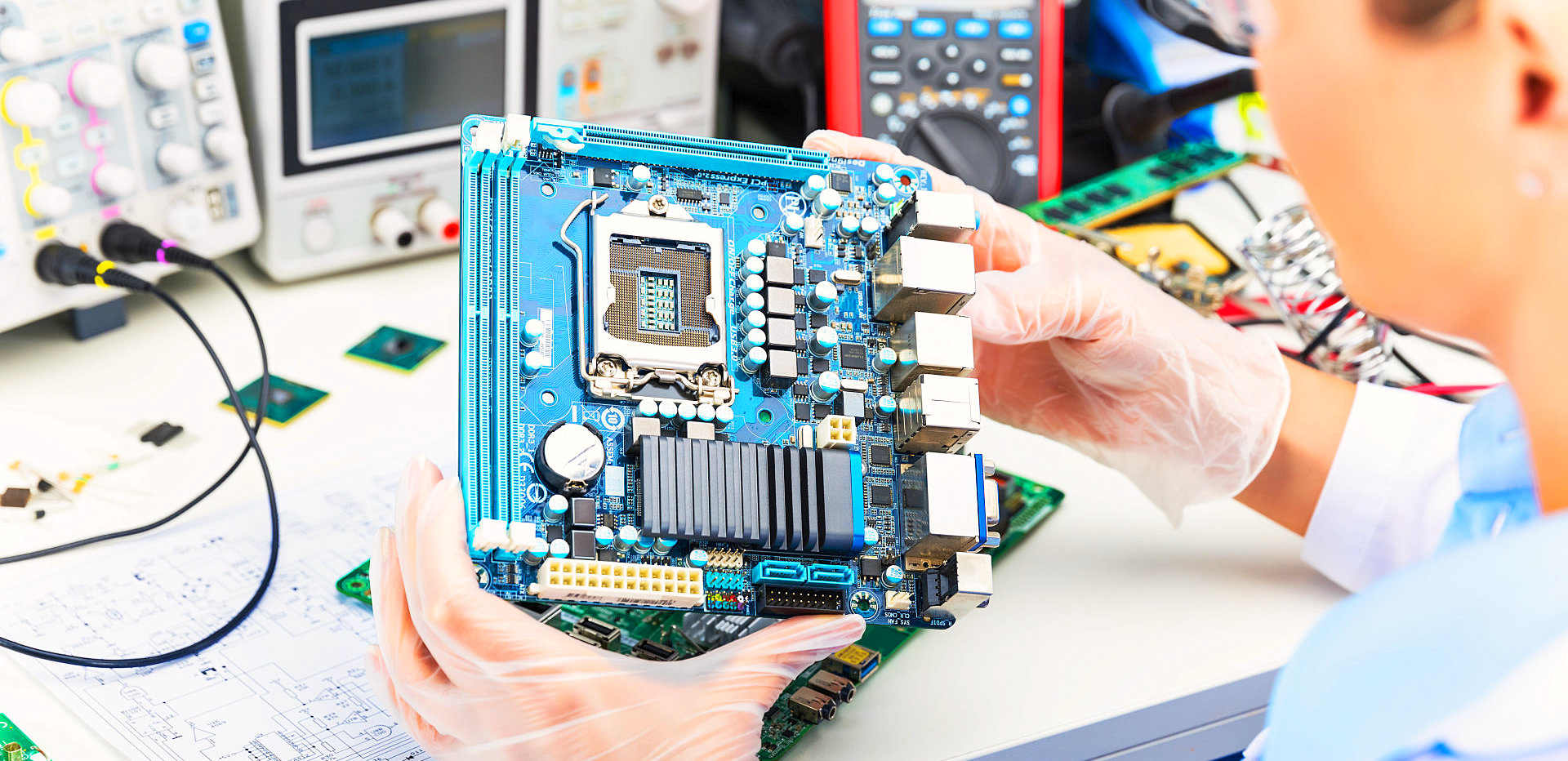 woman holding a motherboard
